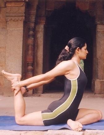 girl in yoga pose backward arc