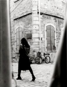 girl walking in old town of Europe