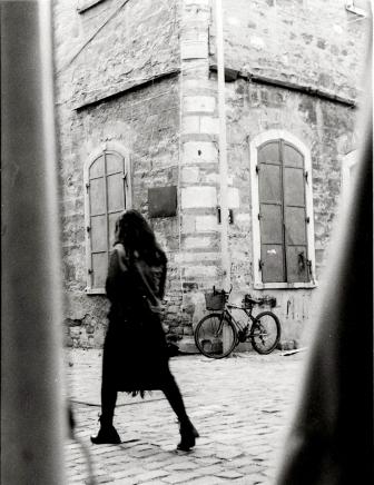 girl walking in old town of Europe